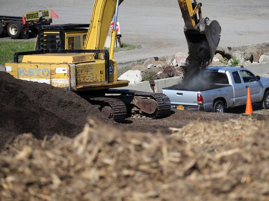 A truck is loaded with mulch made from chipped trees including ash trees. Terry Tree Service in Chili is the official drop-off point for all infested ash trees that have been cut down.