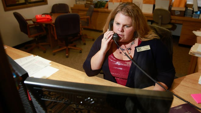 Chief Deputy San Juan County Clerk Tanya Shelby answers a voter's questions during a phone call on Tuesday at the San Juan County Clerk's Office in Aztec. Shelby was elected as county clerk on Tuesday.