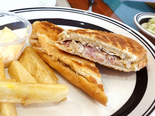 Cuban sandwich with fried yuca at The Latin Kitchen in Mesa.