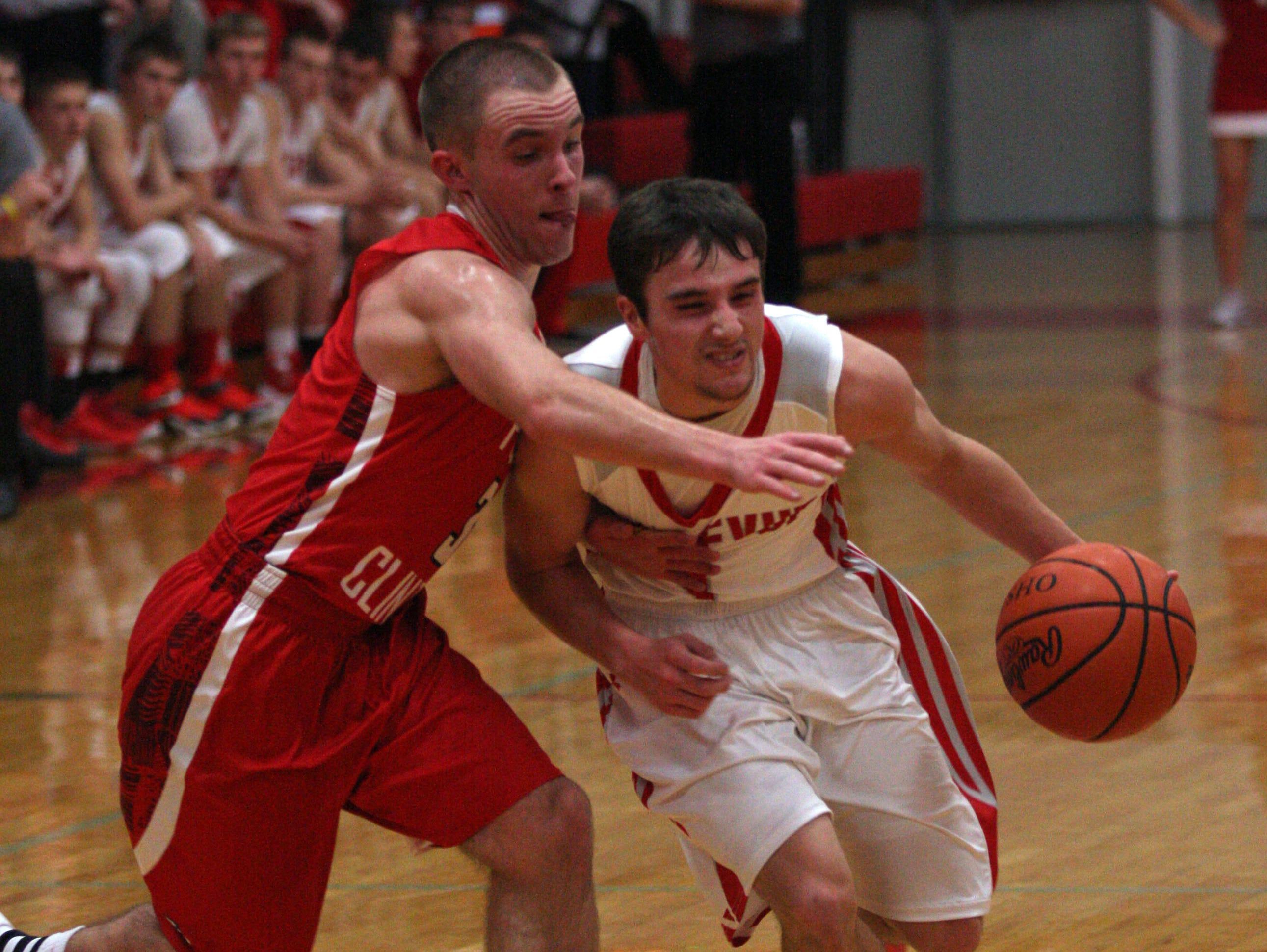 Bellevue's Kyle Geary drives to the basket Thursday as Port Clinton's Kaleb Mizener defends.
