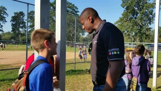 Mayor Andrew Gillum greets Raa Middle School students on their first day back after Hermine.