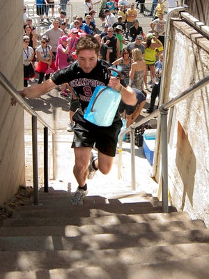 An ice man cometh. Participants in the Iron Man Ice Competition must climb 155 stairs, run down a pathway and then descend a steep hill all while carrying a 10-pound block of ice using antique ice-block tongs. The event is part of the Bisbee 1000: The Great Stair Climb on Oct. 17.