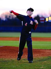 A young Peyton Arnold throws a pitch in 2009.