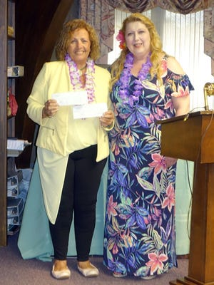 June Lang, chairperson of the Woman's Club of Vineland's Dolly & Me Tea, presents Carol Cohen, executive director of the American Red Cross of Atlantic, Cape May and Cumberland counties, with a check for $400 representing the proceeds from the club's annual Dolly & Me Tea.