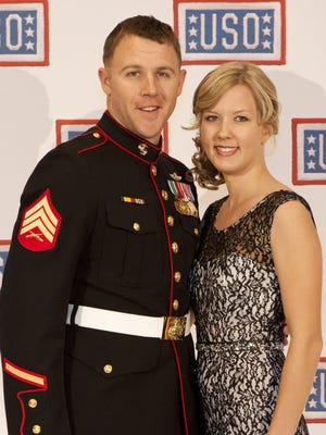 Sgt. Andrew Seif poses for a photo with his wife during the reception before the 2013 USO Gala in Washington, D.C. in 2013 after being named the organization's Marine of the Year. Seif will be awarded the Silver Star for heroic actions in Afghanistan.