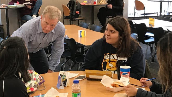Billionaire liberal activist Tom Steyer was at Marquette University's Student Union Tuesday, speaking with Mia Schunk (left), Melissa Reyes (center) and Monique Pineda.