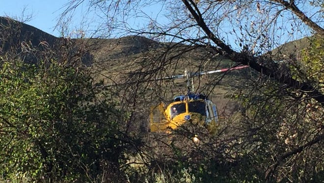 FILE PHOTO A Ventura County helicopter in rugged terrain.