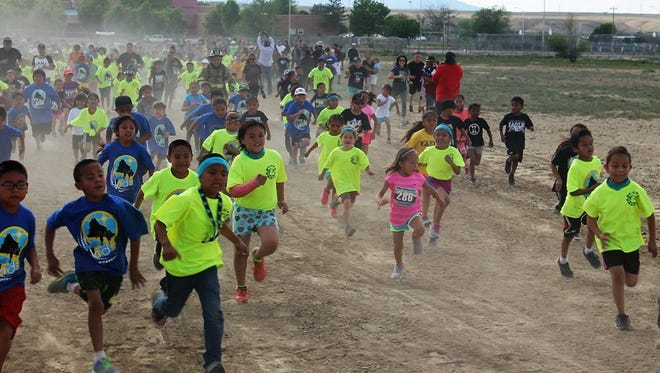 Participants in the Shiprock Marathon kids marathon complete their final mile on May 12 at Diné College's south campus in Shiprock.