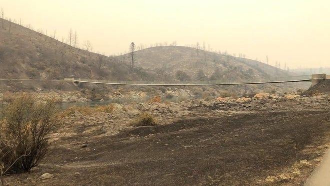 Landscape surrounding the Sacramento River Trail's ribbon bridge after the Carr Fire.