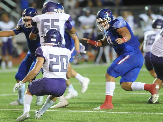 Cooper's Anthony Arellano, right, bottles up El Paso Eastlake's Ivan Avina (20) in the backfield. Cooper beat El Paso Eastlake 42-21 in the Region I-5A Division II area playoff game Friday, Nov. 24, 2017 in Fort Stockton.