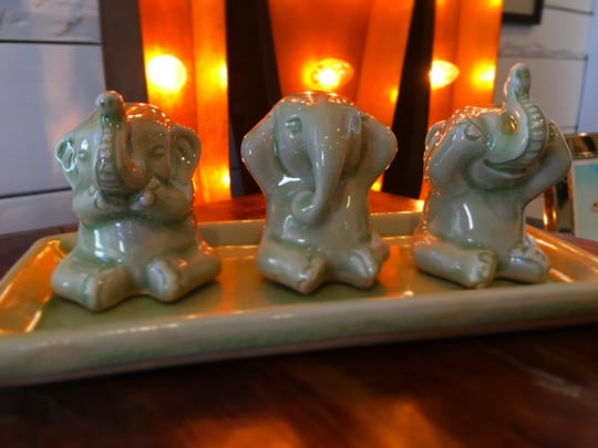 These elephants are made from Thai celadon ceramic.