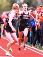 Northville's Ben Cracraft (right) hands off to Jacob Blackmore in the 3,200-meter relay.