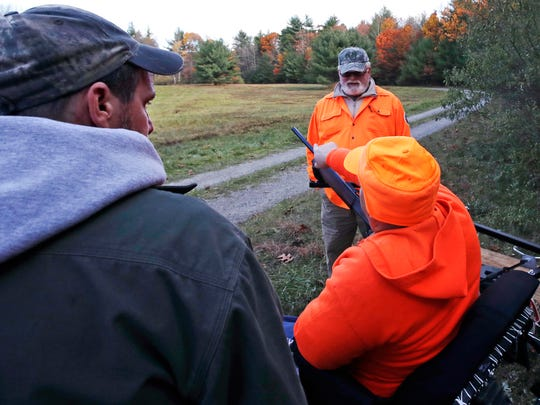In this Friday, Nov. 4, 2016 photo, paraplegic hunt
