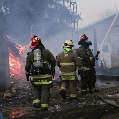 Firefighters battle a pair of structure fires at North