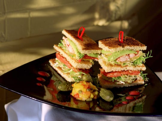 STORY: Cuisine Restaurant. DATE: Friday, Dec. 21, 2001 CAPTION: Lobster club sandwich with avocado, mango, on grilled brioche as prepared by chef/owner Paul Grosz <CQ>. $10 at Cuisine in Detroit