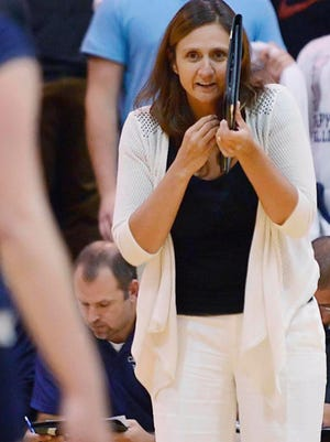 Patty Griffith Langanis coaches during a match for Cary-Grove High School, where she has piled up more than 670 career victories.