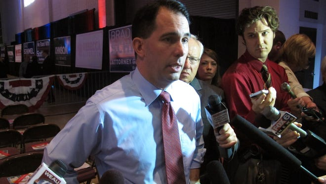 Gov. Scott Walker takes questions before his speech at the Wisconsin Republican Party convention on May 15 in La Crosse.