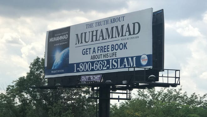 "A pro-Muslim billboard created by GainPeace as a response to the anti-Muslim ""Perfect Man"" billboard that went up in June 2017, is visible from the northbound lanes of Interstate 465 in Indianapolis."