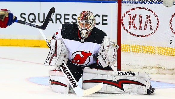Devils goaltender Keith Kinkaid (1) makes a save against