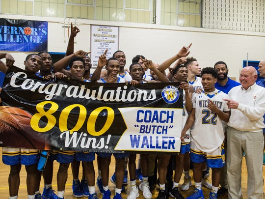 Members of the Wi-Hi boy's basketball team celebrate the 800th win of their coach Butch Waller on Thursday, Feb. 1, 2018.