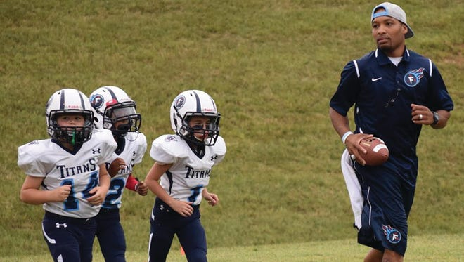 Coach Avion Black on the Fairview Titans Jr Pro Football field last season.