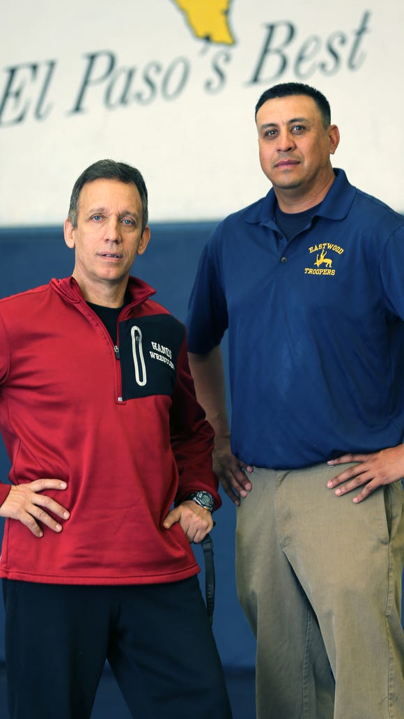 Hanks Tony Carter, left, earned national recognition on Monday. Eastwood coach Rocky Rodriguez is at right.