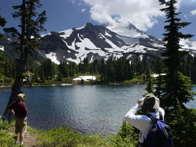 Hikers look out at Mount Jefferson over Scout Lake at Jefferson Park.    -Hikers look out at Mt. Jefferson on Scout Lake in the Jefferson Park Wilderness. photo by Diane Stevenson