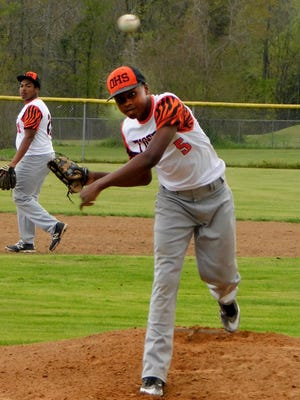 Opelousas High pitcher Collin Guillory aims a throw toward home plate Monday during the Tigers' game with Eunice High. Guillory appeared in middle inning relief for the Tigers, who lost to Eunice 14-2.