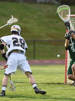 Highland's Dylan Cuvelier shoots on Cornwall's goalie, Ryan Guild during Wednesday's game at Highland. Cuvelier went on to score seven goals during the game.