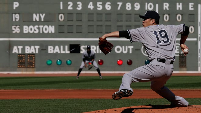 Yankees starting pitcher Masahiro Tanaka delivers to the Boston Red Sox during the first inning of  Saturday's game at Fenway Park in Boston.