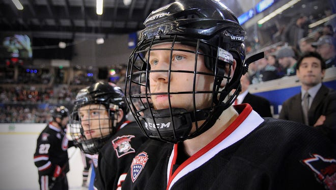 St. Cloud State's Kalle Kossila watches from the bench during the NCAA West Regional Ice Hockey Tournament in March 2014 at Scheels Arena in Fargo, North Dakota.
