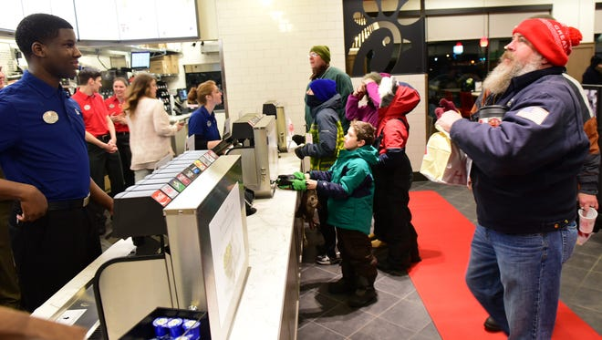Customers place breakfast orders early morning, Jan. 28, 2016 during a promotion in which Chick-fil-A is giving away 52 sandwich meals to each of the first 100 people in line at the Norland Avenue store, Chambersburg.
