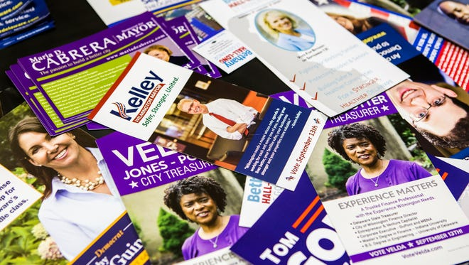 Campaign materials rest on a table during the Wilmington mayoral debate at the Holy Trinity Greek Orthodox church in Wilmington on July 19. The primary Tuesday was far more crowded than previous years.