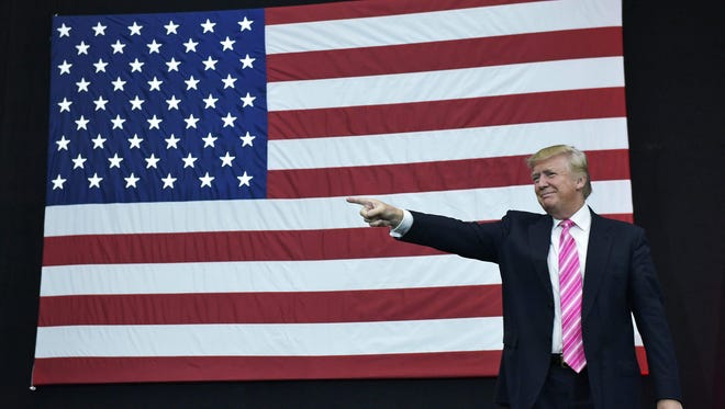 Republican presidential nominee Donald Trump arrives for a rally at Spooky Nook Sports center in Manheim, Pa., on Saturday, Oct. 1, 2016.