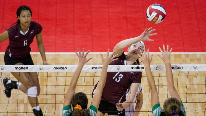 Menomonee Falls' Rachel Murphy hits the ball near Greendale's Alyssa Rinelli (bottom left) during the 2016 WIAA Division 1 state tournament. Falls is once again among the state's elite teams, and it showed in a five-set win over Divine Savior Holy Angels on Sept. 26.