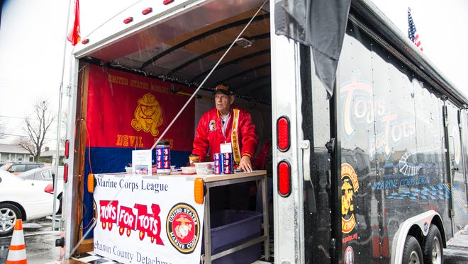 John Gingrich Sr., Toys for Tots Coordinator, collects donations outside of the Golden Corral on Thursday, Dec. 1, 2016.