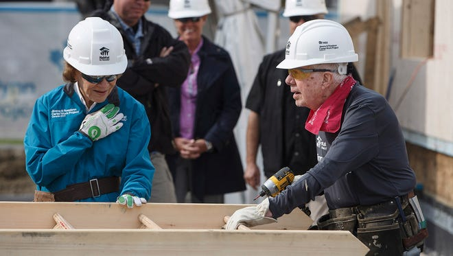 Former president Jimmy Carter and his wife, Rosalynn, help build homes for Habitat for Humanity in Edmonton, Canada, on Tuesday, July 11, 2017. The former president was treated for dehydration Thursday,  July 13, 2017, while working on a Habitat for Humanity home in Winnipeg.