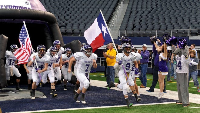 The Throckmorton Greyhounds run out onto the field before the Class A Div. II Championship game against Groom at AT&T Stadium in Dallas Saturday morning.