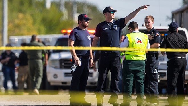 Law enforcement officials work the scene of a fatal shooting at the First Baptist Church in Sutherland Springs, Texas, on Sunday, Nov. 5, 2017.