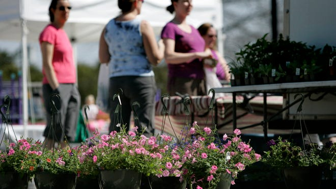 Flower baskets in bloom greeted shoppers to a past Menomonee Falls Farmers Market. The 2018 market will open May 2 in its new location behind A.J. O'Brady's Irish Pub and Grill, N88 W16495 Main St.