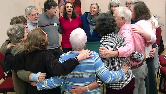 In this Feb. 17, 2016 still image from video, members of Threshold Choir gather and singing in Littleton, Mass.  One of a growing number of hospice choirs across the country, the all-volunteer group sings, by invitation only,  at the bedsides of the elderly and terminally ill in hospitals, nursing homes and private residences. (AP Photo/Rodrique Ngowi)