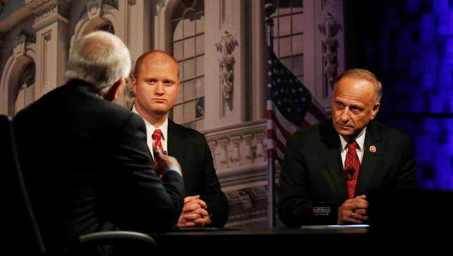 House candidates Jim Mowrer and Steve King prepare to debate at Buena Vista University in Storm Lake, Iowa, Thursday, Oct. 23, 2014.