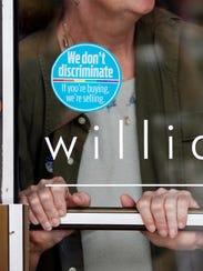 anti-discrimination sticker at hair salon