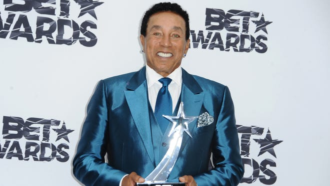 Smokey Robinson poses with the lifetime achievement award in the press room at the BET Awards at the Microsoft Theater on Sunday, June 28, 2015, in Los Angeles.