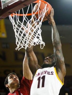 ASU's Savon Goodman prepares to dunk the ball as Stanford's