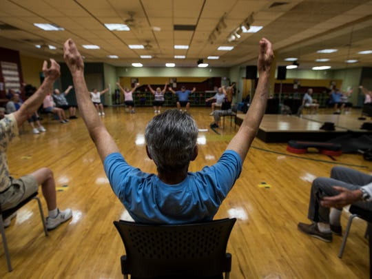 Cape Coral Wellness Center members participate in a group exercise class for Parkinson's patients.