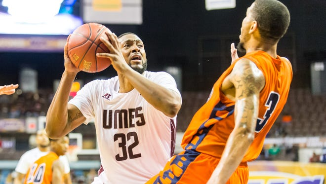 UMES forward Dominique Elliot (32) drives to the basket against Morgan State during the MEAC Tournament at The Scope in Norfolk on Tuesday, March 8.