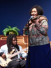 Nimco Yasin sings one of her favorite songs at the request of students Thursday, April 13, at Apollo High School.