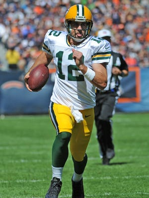 Green Bay Packers quarterback Aaron Rodgers improvised several times during Sunday's game against the Chicago Bears at Soldier Field.
