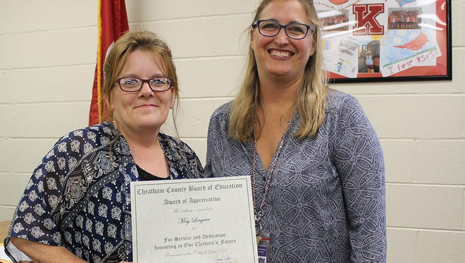 The Cheatham County School Board recognized Cheatham County Public Library Director May Lingner and Ashland City Elementary School assistant Carmen Claudio at its June 5 meeting for their work in issuing more than 160 new library cards over the past several months. Many of the cards were issued to our English Language Learner students and about 50 of the cards came from the recent Pre-K Carnival. Mrs. Lingner (left) is pictured with Interim Director of Schools Stacy Brinkley.